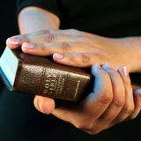 Worship time. A view with hands and bible during worship time Royalty Free Stock Photos