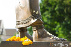 Worship to old thai king statue by marigold. Thai people use marigold to worship king statue Royalty Free Stock Image