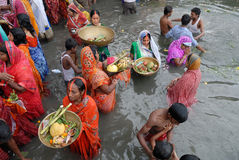 Worship To The Sun God. Hindu devotees stand in waters of Beleghata lake to offer prayers to sun god during the Hindu religious festival Chhat Puja in Kolkata Stock Image
