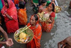 Worship To The Sun God. Women stand in waters of Beleghata lake to offer prayers to sun god during the Hindu religious festival Chhat Puja in Kolkata royalty free stock photography