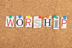 Worship. The word Worship in cut out magazine letters pinned to a cork notice board royalty free stock photos