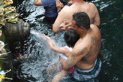 Worshipers bathing in Holy Water Temple Tirta Empul Bali Stock Photos