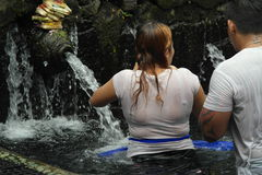 Worshipers bathing in Holy Water Temple Tirta Empul Bali Stock Photo