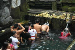Worshipers bathing in Holy Water Temple Tirta Empul Bali Stock Images