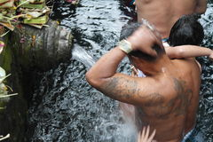 Worshipers bathing in Holy Water Temple Tirta Empul Bali Royalty Free Stock Photography