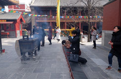 Worshipers holding incense sticks pray at Yonghegong Lama Temple in Beijing Stock Image
