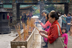 Worshipers at temple Stock Images