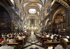 Worshipers during worship in catholic church. SANTA MARIA DE MONTSERRAT, SPAIN - APRIL 9: Worshipers during worship in catholic church on April 9, 2011 royalty free stock photo
