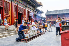Worshippers outside The Hall of Everlasting Protection at the Yonghe Temple, Beijing Royalty Free Stock Photo