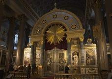 Worshippers pray at Kazan Mother of God. Kazan Cathedral in St. Petersburg royalty free stock photo