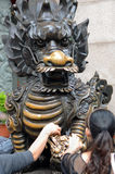 Worshippers Touching Dragon at Wong Tai Sin Temple, Hong Kong Stock Photo