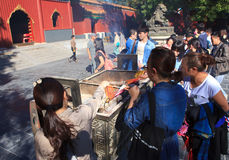 Worshippers at Yonghegong Lama Temple Stock Photo