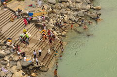 Worshipping by the Ganges river in Rishikesh, India Stock Image