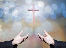 Worshipping God concept,people open empty hands with palms up. Over blurred the cross on sky. Eucharist therapy bless god helping repent catholic easter lent Royalty Free Stock Photography