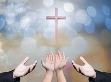 Worshipping God concept,people open empty hands with palms up. Over blurred the cross on sky. Eucharist therapy bless god helping repent catholic easter lent Stock Photography