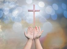 Worshipping God concept,people open empty hands with palms up. Over blurred the cross on sky. Eucharist therapy bless god helping repent catholic easter lent Stock Images