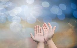 Worshipping God concept,people open empty hands with palms up. Over blurred the cross on sky. Eucharist therapy bless god helping repent catholic easter lent Stock Image