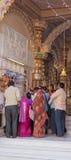 Worshipping at a Hindu shrine Stock Photos