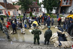 Worst flooding on record across the Balkans in Serbia. SERBIA, SREMSKA MITROVICA - MAY 17: The army, police and citizens together raise the walls banks with stock photo