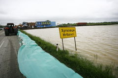Worst flooding on record across the Balkans in Serbia. SERBIA, SREMSKA MITROVICA - MAY 17: The water near the road and sandbags.The water level of Sava River Royalty Free Stock Image