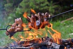 Worsten in de brand Stock Fotografie
