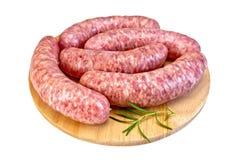 Worstenvarkensvlees op ronde raad Stock Afbeelding