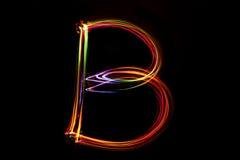 Wort ` B ` Schreiben vom Licht Lizenzfreie Stockbilder