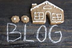 Wort-Blog mit Lebkuchen-Haus Stockbilder