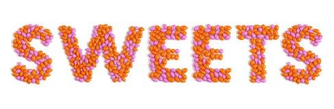 Wort-Bonbons gebildet von den bunten Dragee-Süßigkeiten Lizenzfreies Stockfoto