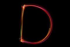 Wort ` D ` Schreiben vom Licht Stockbild