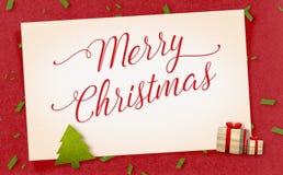 Wort der frohen Weihnachten auf Papierhandwerk der alten Weinlese mit Geschenk und Lizenzfreie Stockbilder