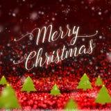 Wort der frohen Weihnachten und Weihnachtsbaum wenn Schnee, der am Rot fällt Stockfoto
