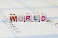 Wort der Welt ausgebreitet auf einem Kalender Stockbilder