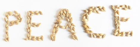 Wort des Friedens gemacht?? mit Körnern des Weizens Lizenzfreie Stockfotos