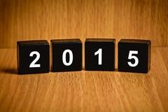 Wort des neuen Jahres 2015 auf schwarzem Block Lizenzfreies Stockbild