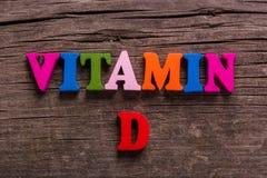 Wort des Vitamins D gemacht von den hölzernen Buchstaben Lizenzfreies Stockbild