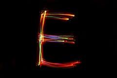 Wort ` E ` Schreiben vom Licht Stockfoto