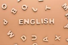 Wort-Englisch auf beige Hintergrund stockbilder