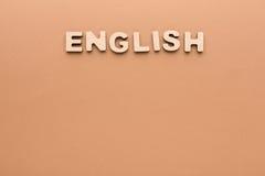 Wort-Englisch auf beige Hintergrund lizenzfreie stockbilder