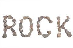 Wort-Felsen gemacht mit kleinen Felsen Lizenzfreie Stockfotografie