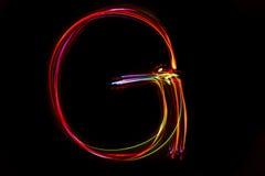 Wort ` G-` Schreiben vom Licht Stockbild
