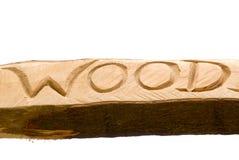 Wort geschnitzt im Holz lizenzfreies stockbild
