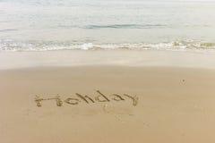 Wort geschrieben in den Strand Lizenzfreie Stockbilder