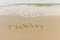 Wort geschrieben in den Strand Stockfotos