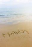 Wort geschrieben in den Strand Stockfotografie