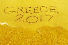 Wort Griechenland 2017 wird auf eine sandige Oberfläche geschrieben Lizenzfreies Stockbild