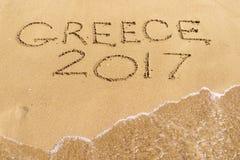 Wort Griechenland 2017 wird auf eine sandige Oberfläche geschrieben Lizenzfreie Stockbilder