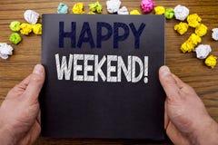 Wort, Heppy-Wochenende schreibend Geschäftskonzept für die Wochenenden-Mitteilung geschrieben auf Notizblocknotizbuchbuch auf dem stockfoto