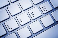 Wort-Leben auf Computertastatur Stockfotos