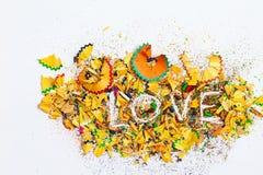 Wort-Liebe über Schnitzel Stockfotografie